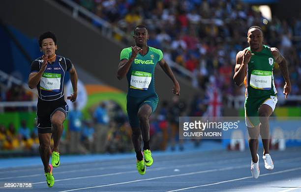 South Korea's Kim Kukyoung Brazil's Vitor Hugo dos Santos and South Africa's Akani Simbine compete in the Men's 100m Round 1 during the athletics...