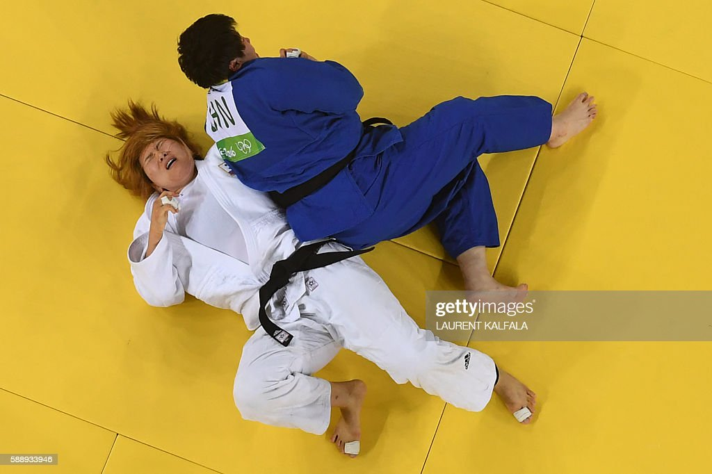 TOPSHOT South Korea's Kim Minjeong competes with China's Yu Song during their women's 78kg judo contest bronze medal B match of the Rio 2016 Olympic...