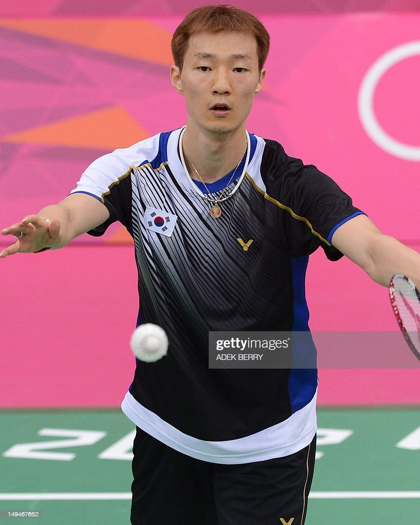 South Korea s Lee Hyun Il serves against