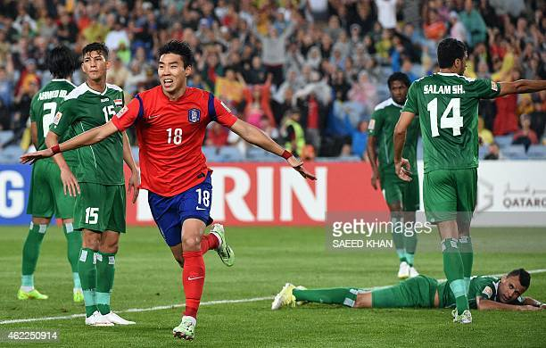 South Korea's Lee Jeonghyeop celebrates his first goal against Iraq during the semifinal football match between South Koreaand Iraq at the AFC Asian...