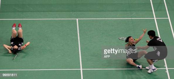 South Korea's Lee Kyung Won and teammate Lee Hyo Jung celebrate following their win against China's Du Jing and Yu Yang during their Uber Cup...