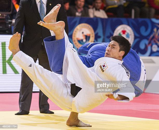 South Koreas Lee Seungsu competes with Canadas Antoine ValoisFortier during the mens bronze medal match in the 81kg category at the Judo World...