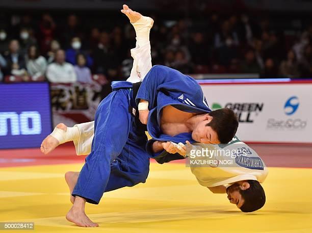 South Korea's Lee Seungsu throws Georgia's Avtandili Tchrikishvili in the men's 81kilogram category final match at the Judo Grand Slam Tokyo on...