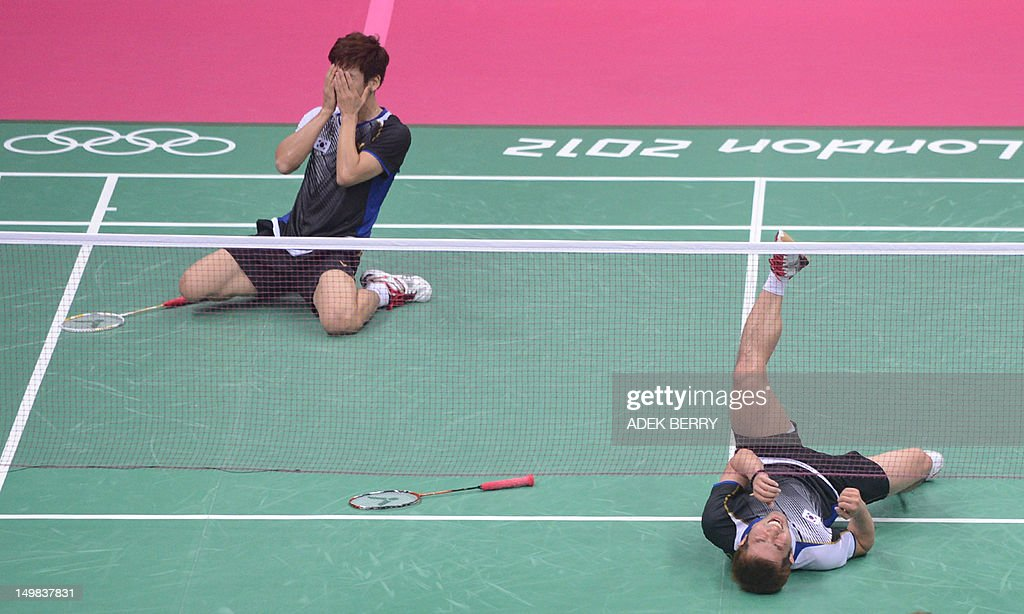 South Korea's Lee Yong Dae (L) and Chung Jae Sung (R) celebrate their victory over Koo Kien Keat and Tan Boon Heong of Malaysia during the bronze medal men's doubles badminton match at the London 2012 Olympic Games in London on August 5, 2012. South Korea won the match 23-12, 21-10. AFP PHOTO /ADEK BERRY