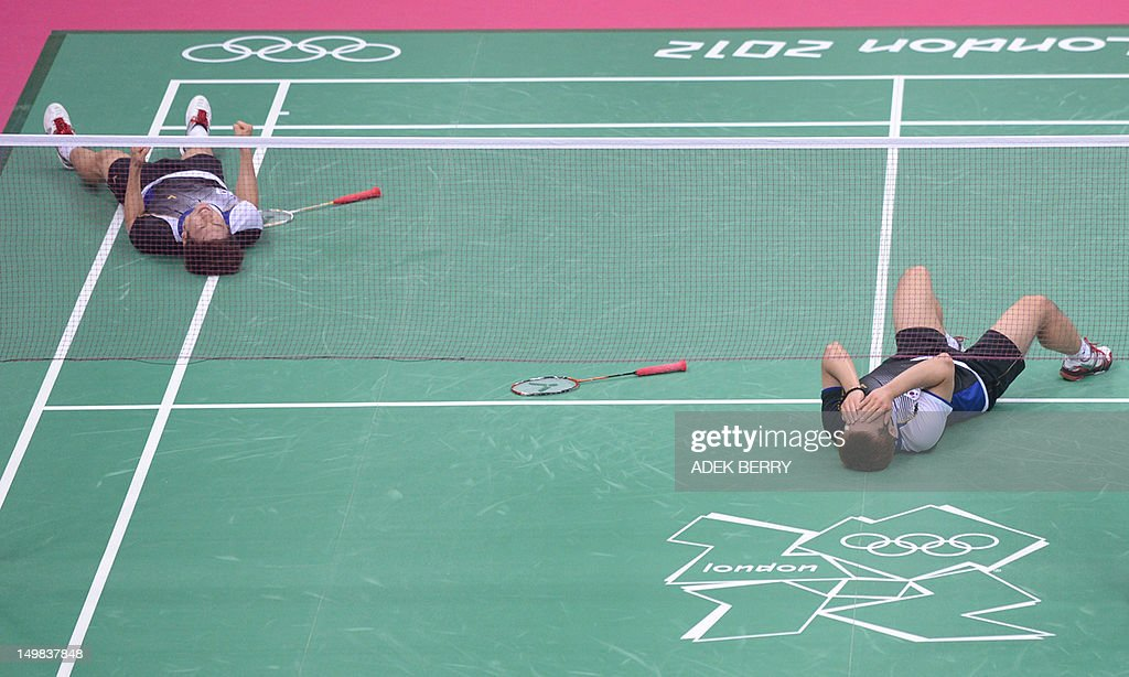 South Korea's Lee Yong Dae (L) and Chung Jae Sung (2L) celebrate their victory over Koo Kien Keat (R) and Tan Boon Heong (2R) of Malaysia during the bronze medal men's doubles badminton match at The London 2012 Olympic Games in London on August 5, 2012. South Korea won the match 23-12, 21-10.