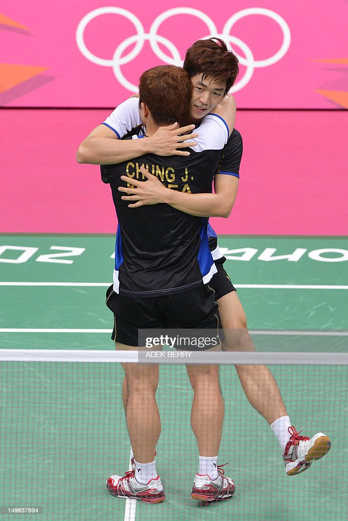 South Korea's Lee Yong Dae and Chung Jae Sung (foreground) celebrate their victory over Koo Kien Keat and Tan Boon Heong of Malaysia during the bronze medal men's doubles badminton match at the London 2012 Olympic Games in London on August 5, 2012. South Korean won the match 23-12, 21-10.