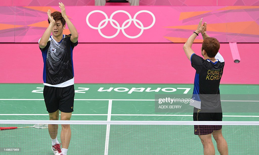 South Korea's Lee Yong Dae (L) and Chung Jae Sung (R) celebrate their victory over Koo Kien Keat and Tan Boon Heong of Malaysia after the bronze medal men's doubles badminton match at The London 2012 Olympic Games in London on August 5, 2012. The South Korean pair won the match 23-12, 21-10. AFP PHOTO /ADEK BERRY