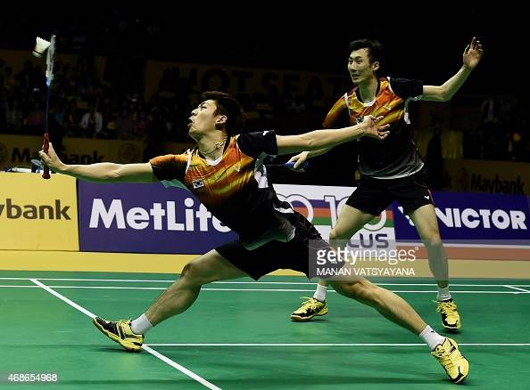 South Korea's Lee Yong Dae and Yoo Yeon Seong compete against Mohammad Ahsan and Hendra Setiawan of Indonesia during their men's doubles final match...