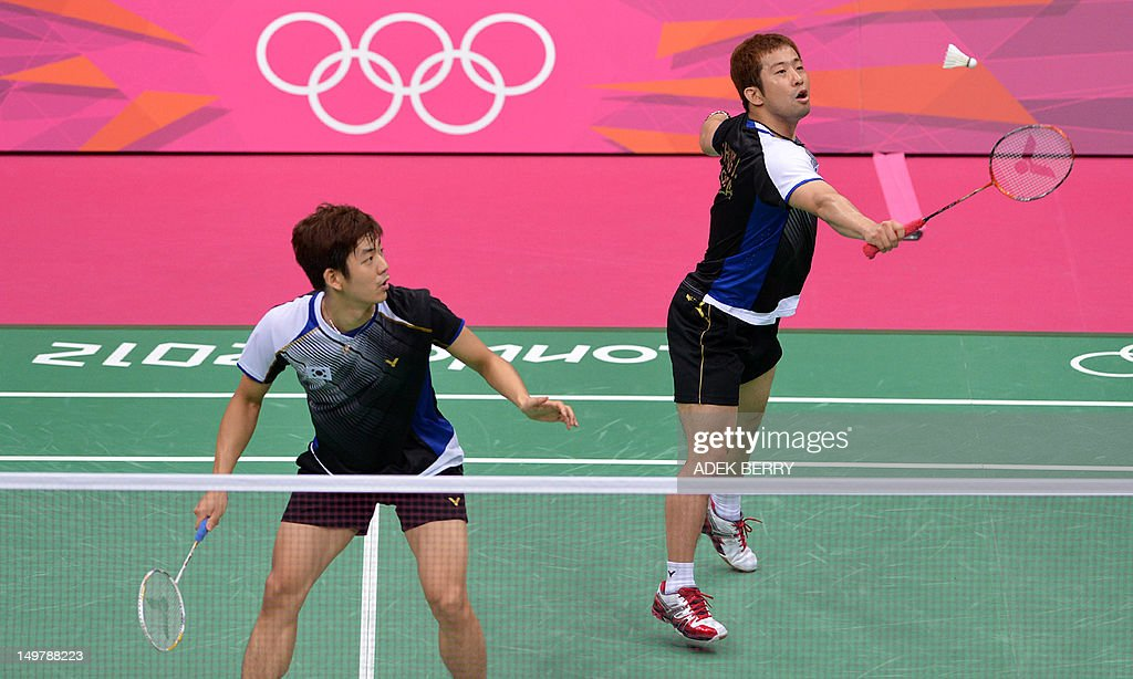 South Korea's Lee Yong Dae (L) looks on as teammate Chung Jae Sung plays a shot during their Badminton men's doubles semifinals match against Denmark's Mathias Boe and Carsten Mogensen at the London 2012 Olympic Games in London on August 4, 2012. Denmark won the match 17-21, 21-18, 22-20.