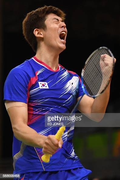 South Korea's Lee Yong Dae reacts during his men's doubles qualifying badminton match witth teammate South Korea's Yoo Yeon Seong against Taiwan's...
