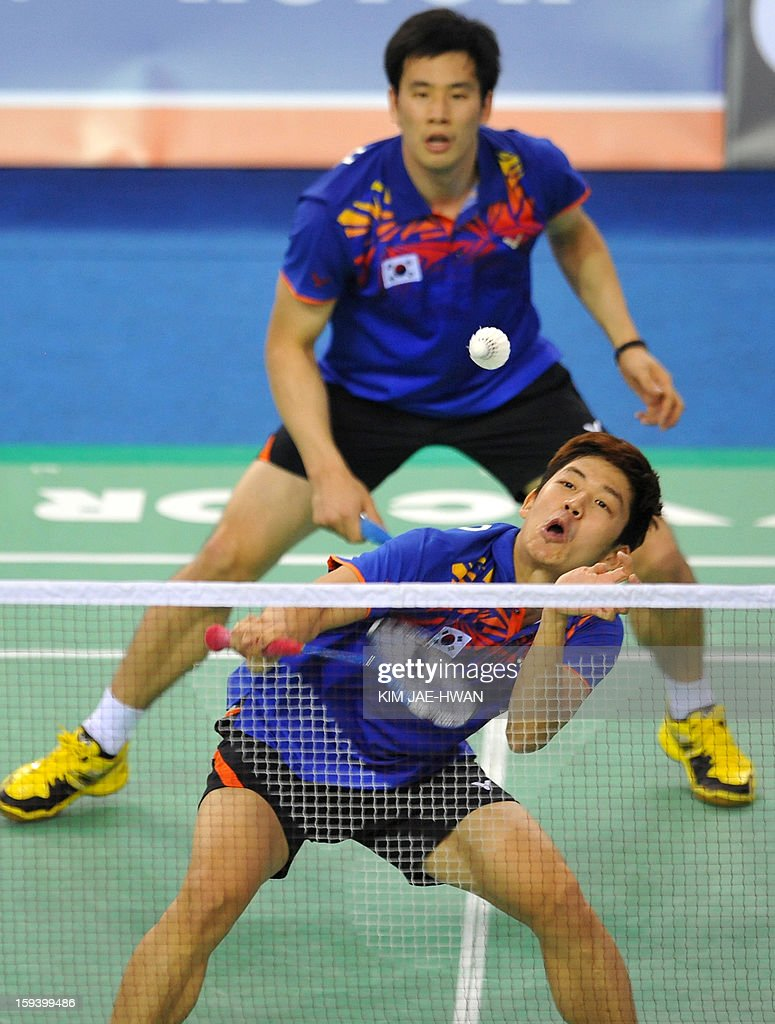 South Korea's Lee Yong-Dae (front) and Ko Sung-Hyun(B) play a shot during their men's doubles badminton match against Mathias Boe and Carsten Mogensen of Denmark during the finals of the Korea Open at Seoul on January 13, 2013. Lee Yong-Dae and Ko Sung-Hyun won the match 19-21, 21-13, 21-10.