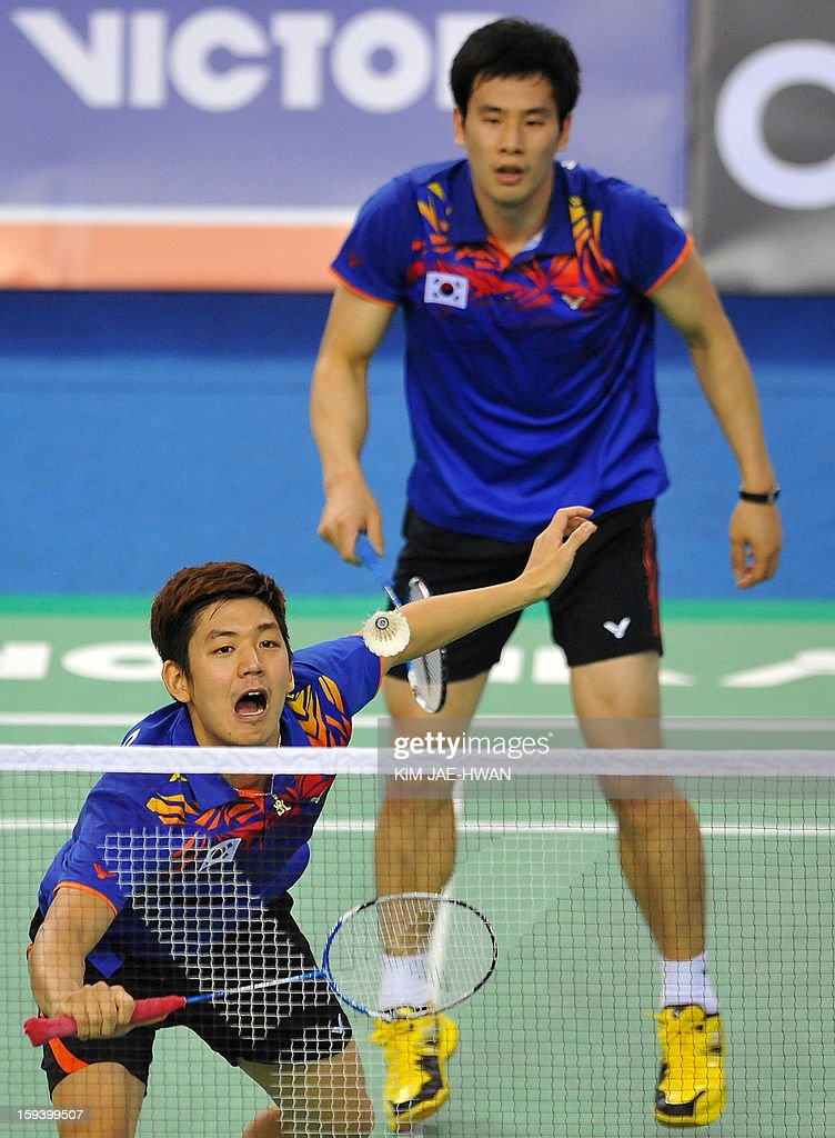 South Korea's Lee Yong-Dae (front) and Ko Sung-Hyun(back) play a shot during their men's doubles badminton match against Mathias Boe and Carsten Mogensen of Denmark during the finals of the Korea Open at Seoul on January 13, 2013. Lee Yong-Dae and Ko Sung-Hyun won the match 19-21, 21-13, 21-10.