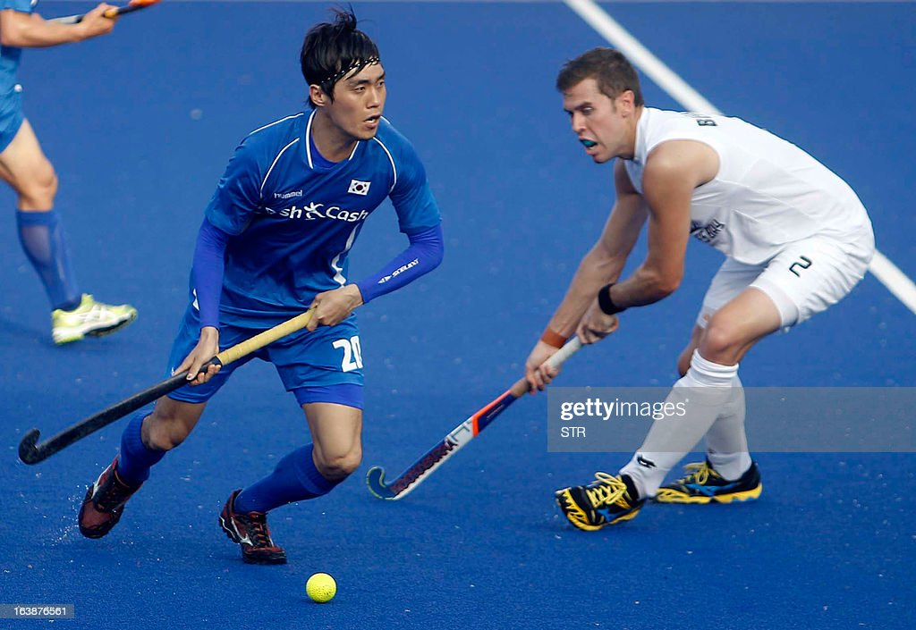 South Korea's Lim Kyung Ju vies against New Zealand's Cory Bennett during a third place playoff match at the Sultan Azlan Shah Cup men's field hockey...