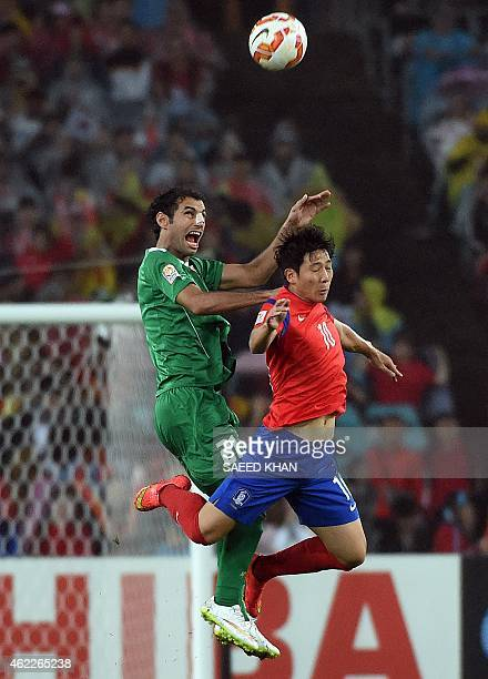 South Korea's Nam Tae Hee and Iraq's Saad Abdulameer fight for the ball during the semifinal football match between South Korea and Iraq at the AFC...