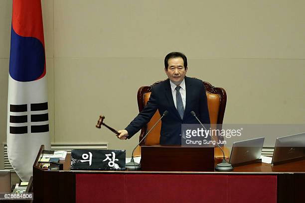 South Korea's National Assembly Speaker Chung SyeKyun bangs a gavel for president impeachment during a plenary session at National Assembly on...