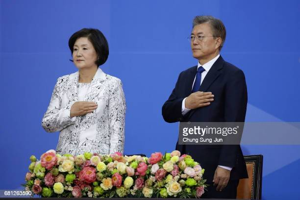 South Korea's new President Moon JaeIn and his wife Kim JungSuk salute during the presidential inauguration ceremony at National Assembly on May 10...