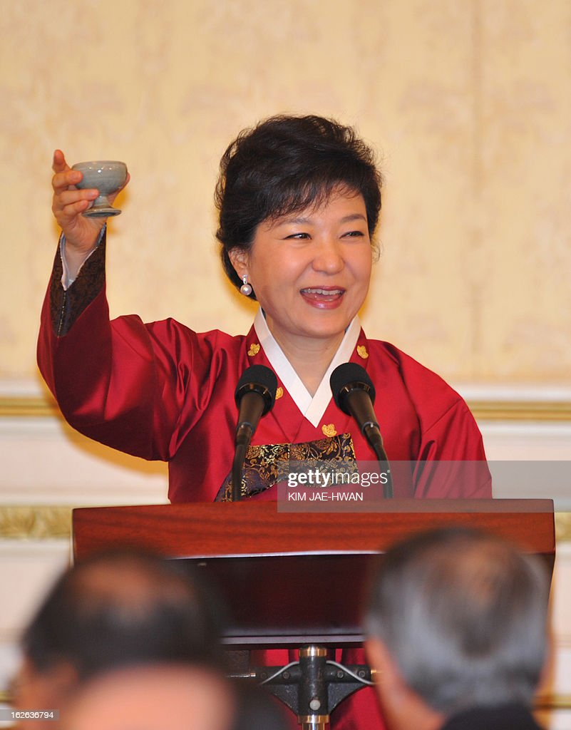 South Korea's new president Park Geun-Hye gestures during an official dinner at the presidential Blue House in Seoul on February 25, 2013. Park Geun-Hye became South Korea's first female president on February 25, vowing zero tolerance with North Korean provocation and demanding Pyongyang 'abandon its nuclear ambitions' immediately. AFP PHOTO /POOL/ KIM JAE-HWAN