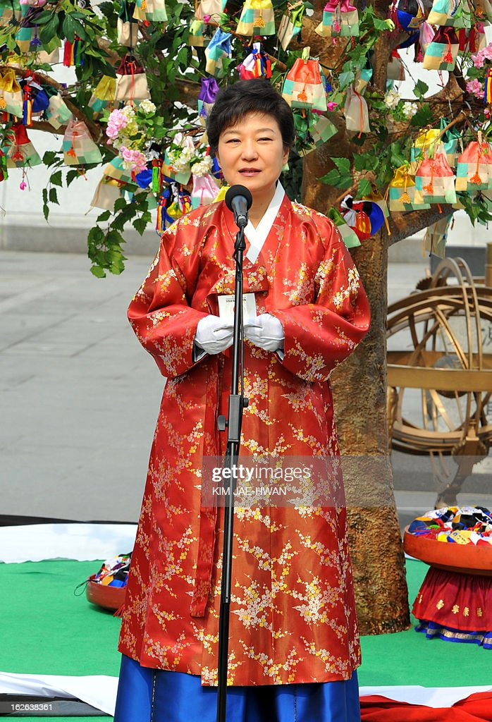 South Korea's new President Park Geun-Hye wearing a traditional Hanbok dress delivers a speech at a plaza on her way to the presidential Blue House after her inauguration in Seoul February 25, 2013. Park Geun-Hye was sworn in as South Korea's first female president on February 25, vowing zero tolerance with provocations from a nuclearised North Korea and a new era of economic prosperity for all. AFP PHOTO / KIM JAE-HWAN