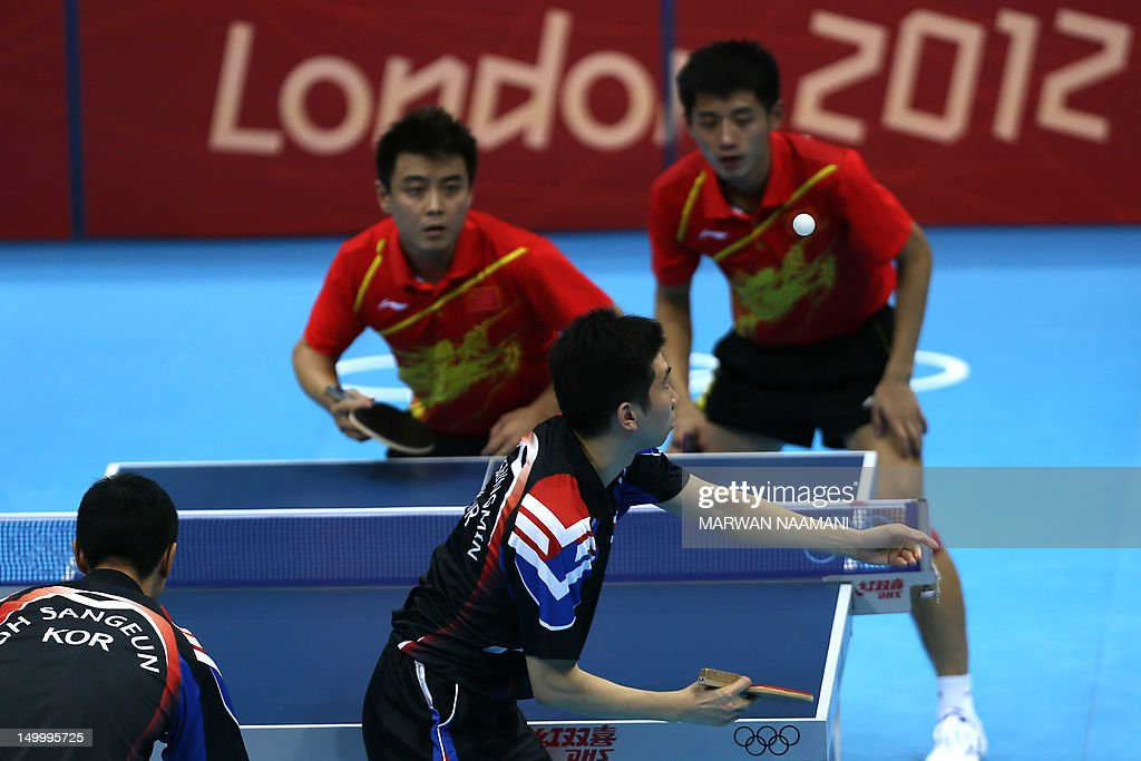 South Korea's Oh Sangeun and South Korea's Ryu Seungmin return a ball to China's Wang Hao and Zhang Jike during the table tennis men's team final China vs South Korea at the London Olympic games on August 8, 2012 at the Excel arena in London.