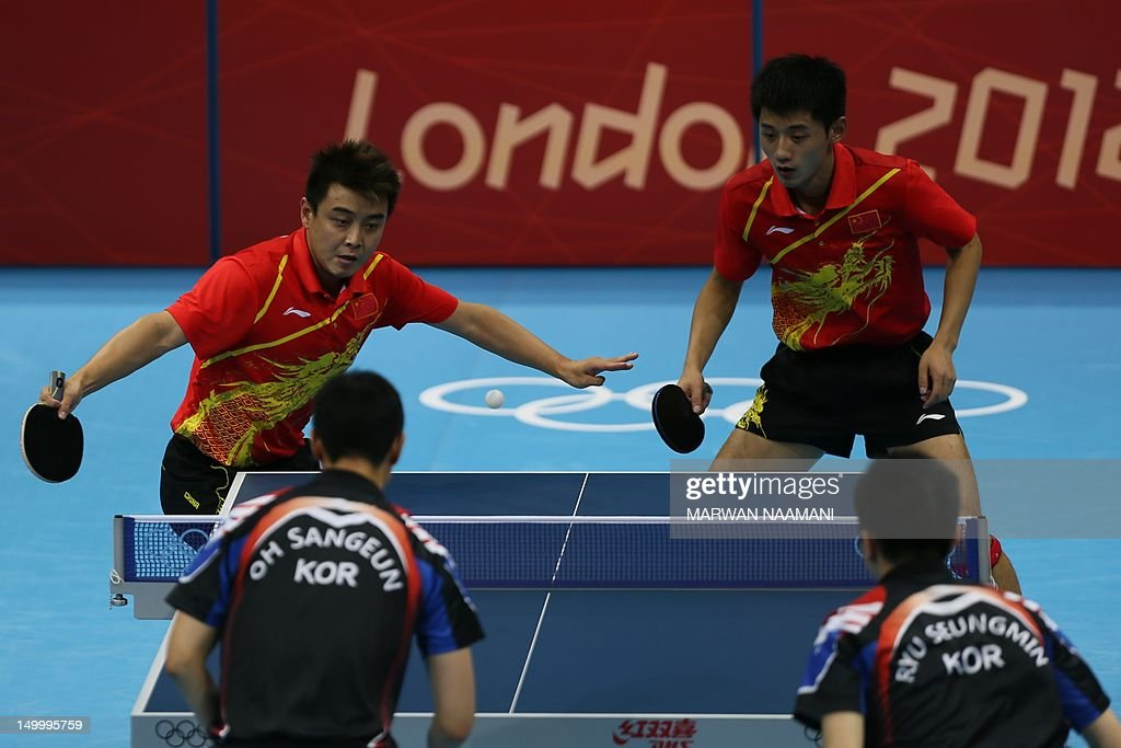 South Korea's Oh Sangeun and South Korea's Ryu Seungmin (front) return a ball to China's Wang Hao and Zhang Jike during the table tennis men's team final China vs South Korea at the London Olympic games on August 8, 2012 at the Excel arena in London. AFP PHOTO / MARWAN NAAMANI