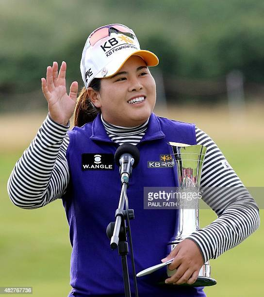 South Korea's Park Inbee celebrates her victory with the trophy after her final round 65 on day four of the Women's British Open Golf Championships...