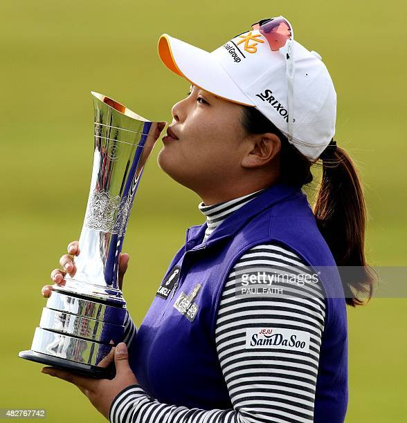 South Korea's Park Inbee kisses the trophy as she celebrates her victory after her final round 65 on day four of the Women's British Open Golf...