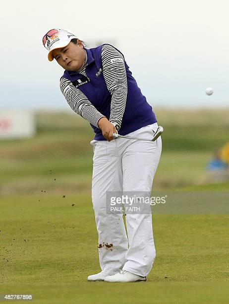 South Korea's Park Inbee plays her approach from the 18th fairway during her final round 65 on day four of the Women's British Open Golf...