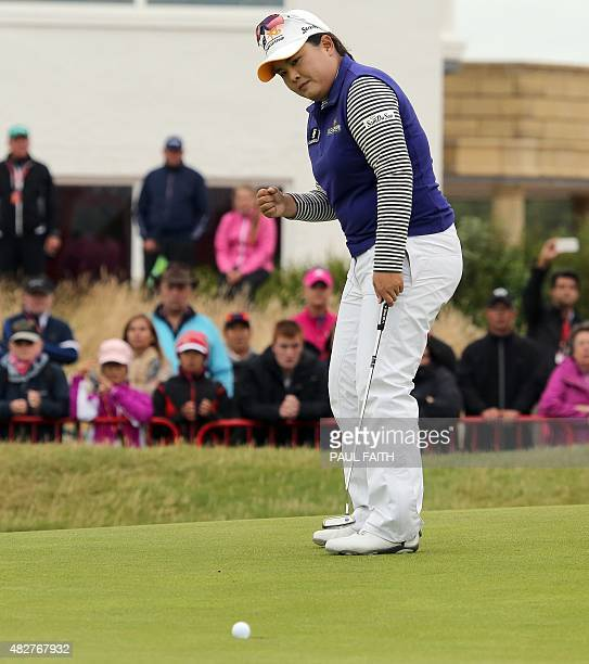 South Korea's Park Inbee reacts on the 18th green during her final round 65 on day four of the Women's British Open Golf Championships in Turnberry...