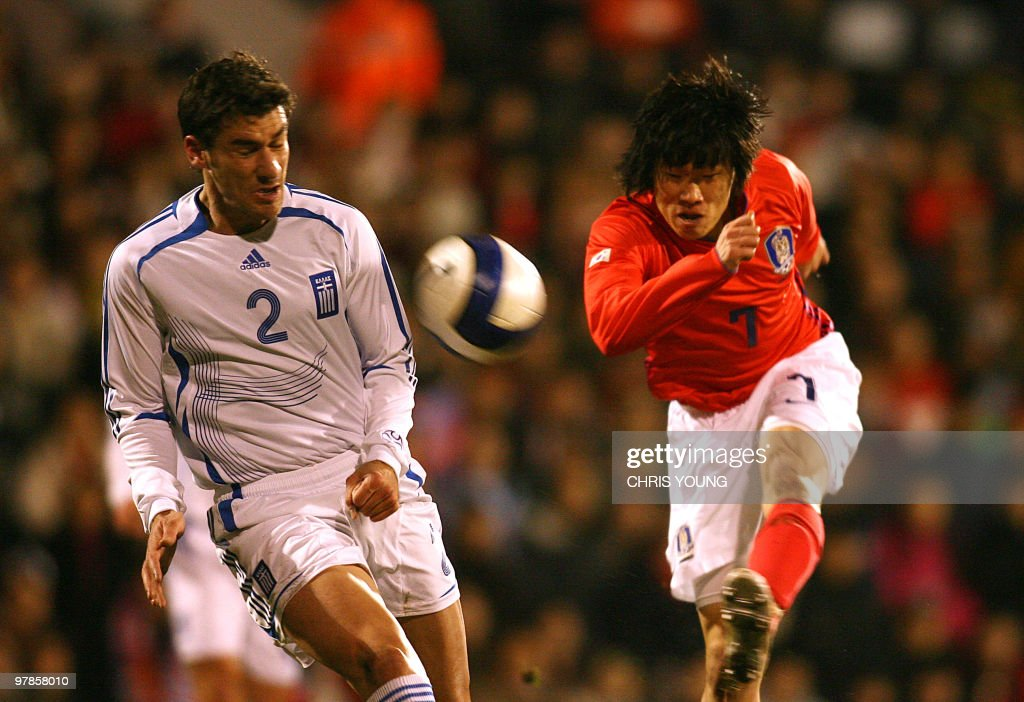 South Korea's Park Ji Sung vies with Greece's Georgios Seitaridis during their friendly International football match at Cravern Cottage in London 06...