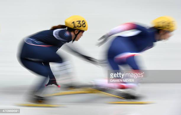South Korea's Park SeungHi and France's Veronique Pierron compete in the Women's Short Track 1000 m Quarterfinals at the Iceberg Skating Palace...