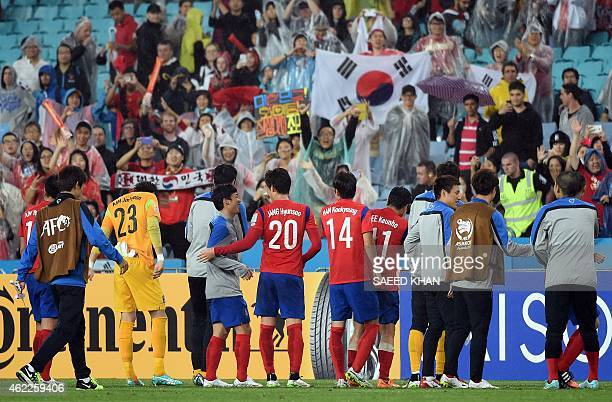 South Korea's players celebrate their victory against Iraq in the semifinal football match between South Korea and Iraq at the AFC Asian Cup in...