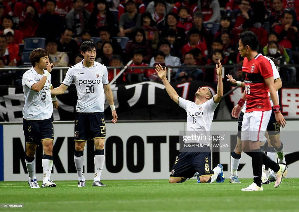 South Korea's Pohang Steelers forward Veselinovic Lazar (C) celebrates his goal in the penalty kick during their AFC champions league group H football match against Japan's Urawa Reds in Saitama on May 3, 2016. / AFP / TOSHIFUMI