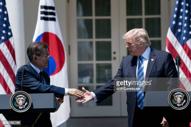 South Korea's President Moon Jaein and US President Donald Trump shake hands while making statements in the Rose Garden of the White House June 30...