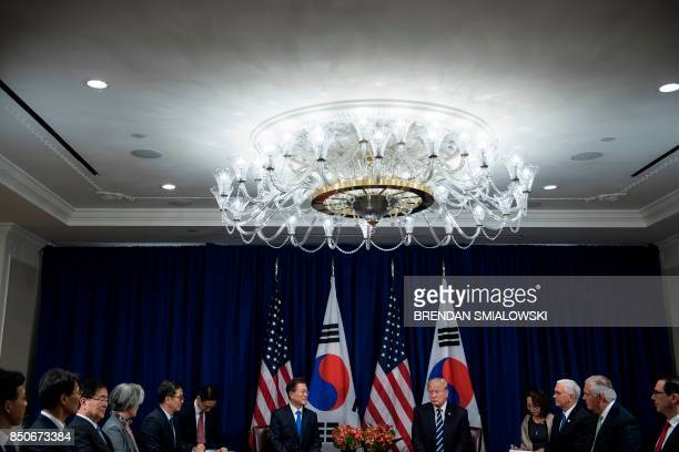 TOPSHOT South Korea's President Moon Jaein and US President Donald Trump wait for a meeting at the Palace Hotel during the 72nd United Nations...