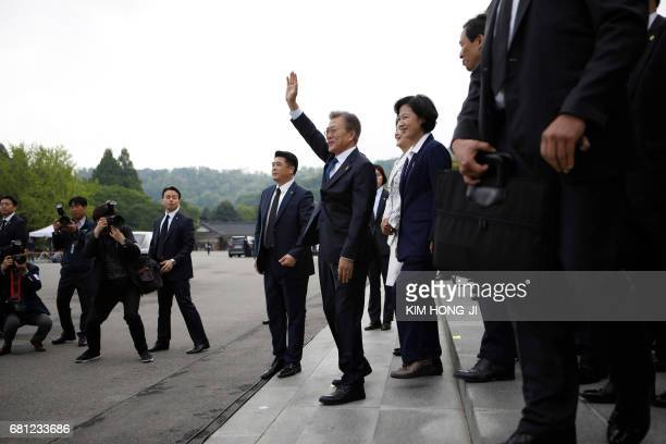 South Korea's President Moon Jaein waves to his supporters as he leaves at the National Cemetery in Seoul on May 10 2017 Leftleaning former human...