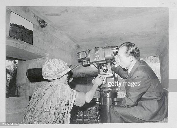 South Korea's President Park Chung Hee looks North of the military demarcation line through a telescope at a missle encampment on the central...