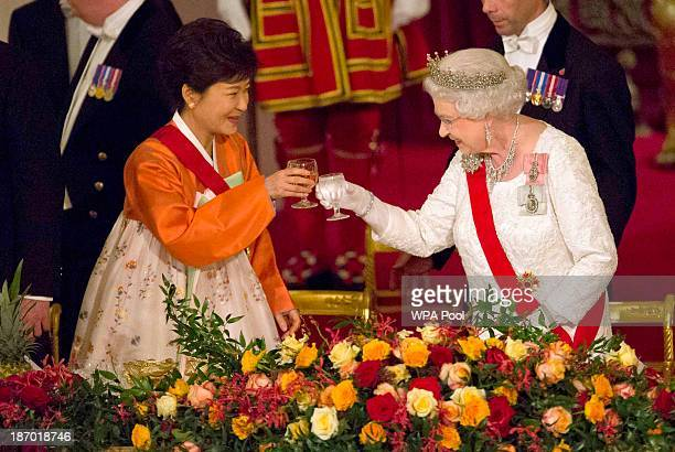 South Korea's President Park Geunhye and Britain's Queen Elizabeth II toast at a state banquet at Buckingham Palace on November 5 2013 in London...