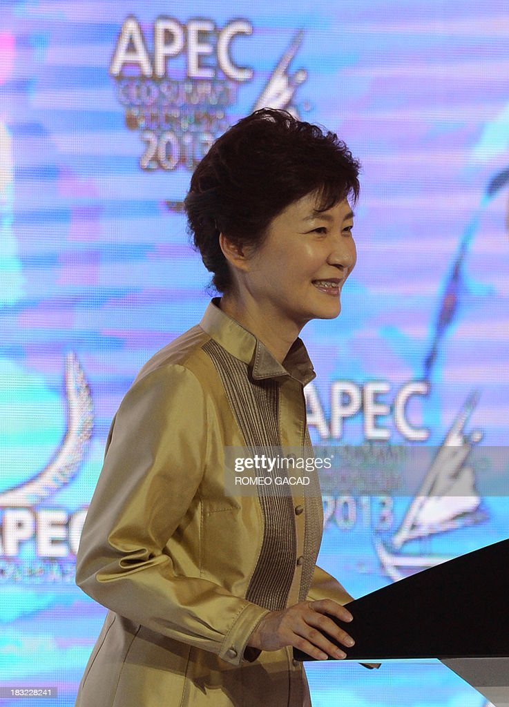 South Korea's President Park Geun-Hye delivers an address at the Asia-Pacific Economic Cooperation (APEC) CEO Summit attended by leaders of APEC member countries and top international business executives in Nusa Dua on the Indonesian resort island of Bali on October 6, 2013. Leaders of the 21-member APEC grouping are arriving in Bali ahead of the leader's summit on October 7-8.