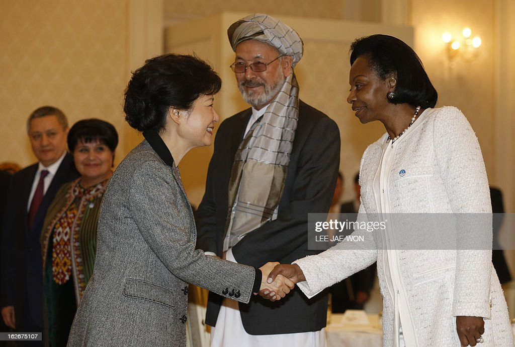 South Korea's President Park Geun-Hye (L) greets Marie Madeleine Mborantsuo (R), president of the constitutional court of Gabon as Afghanistan's vice president Karim Khalili (C) watches on during a meeting at the presidential Blue House in Seoul on February 26, 2013. Park Geun-Hye became South Korea's first female president Monday, vowing zero tolerance with North Korean provocation and demanding Pyongyang 'abandon its nuclear ambitions' immediately. AFP PHOTO / POOL / Lee Jae-Won