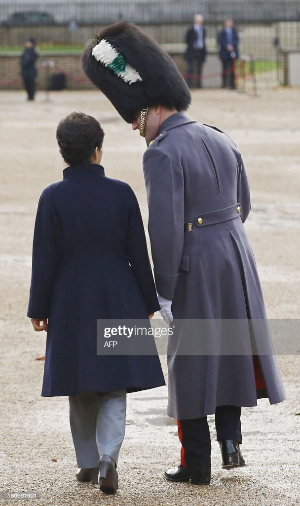 South Korea's President Park Geun-hye (L) is escorted by a Guardsman during a ceremonial welcome at Horseguards Parade in central London, on November 5, 2013, at the start of a three day state visit to Britain by the South Korean President.
