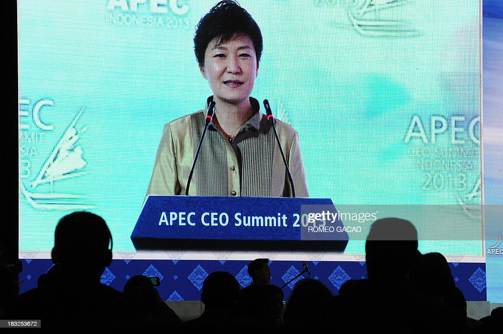 South Korea's President Park Geun-Hye is pictured on a large video screen as she speaks at the Asia-Pacific Economic Cooperation (APEC) CEO Summit attended by leaders of APEC member countries and top international business executives in Nusa Dua on the Indonesian resort island of Bali on October 6, 2013. Leaders of the 21-member APEC grouping are arriving in Bali ahead of the leader's summit on October 7-8.
