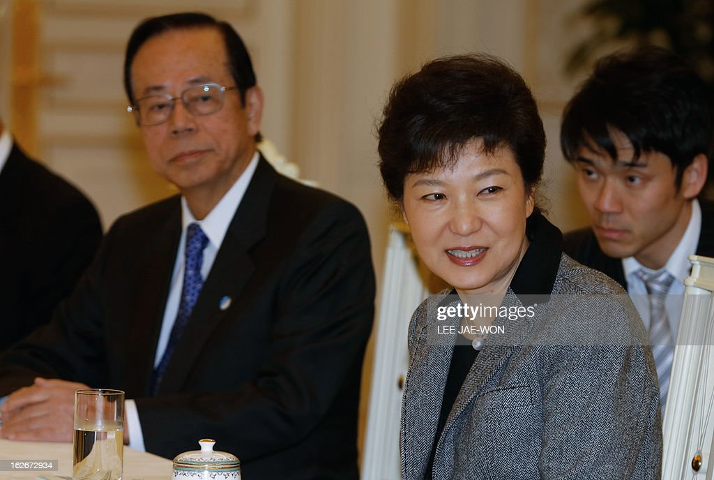 South Korea's President Park Geun-hye (front R) meets Japan's former Prime Minister Yasuo Fukuda (L) and other Japanese lawmakers at the presidential Blue House in Seoul February 26, 2013. Park Geun-Hye became South Korea's first female president on February 25, vowing zero tolerance with North Korean provocation and demanding Pyongyang 'abandon its nuclear ambitions' immediately. AFP PHOTO / Lee Jae-Won / POOL