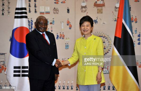 South Korea's President Park GeunHye shakes hands with Mozambique's President Armando Guebuza before a summit at the presidential Blue House in Seoul...