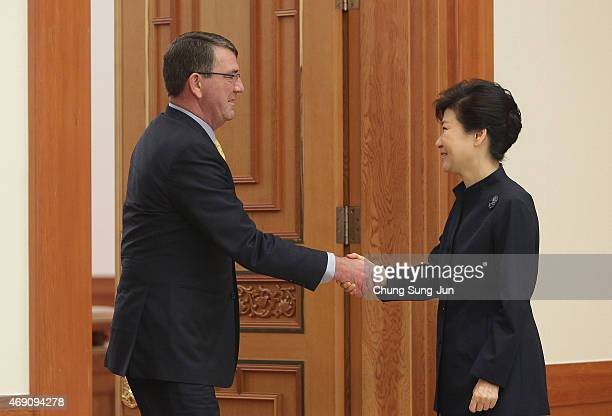 South Korea's President Park GeunHye shakes hands with US Secretary of Defense Ashton Carter before their meeting at the presidential Blue House on...