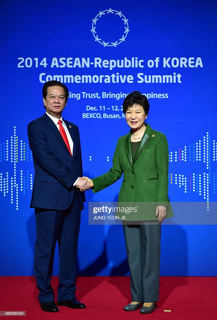 South Korea's President Park Geun-Hye (R) welcomes Vietnam's Prime Minister <a gi-track='captionPersonalityLinkClicked' href=/galleries/search?phrase=Nguyen+Tan+Dung&family=editorial&specificpeople=544511 ng-click='$event.stopPropagation()'>Nguyen Tan Dung</a> (L) before the first session of the ASEAN-Republic of Korea Commemorative Summit in Busan on December 12, 2014. Leaders from a group of 10 Southeast Asian countries are in Busan to attend a two-day special summit hosted by South Korean President Park Geun-Hye. AFP PHOTO / POOL / JUNG YEON-JE