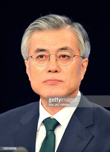 South Korea's presidential candidate Moon JaeIn of the main opposition Democratic United Party attends a televised debate in Seoul on December 10...