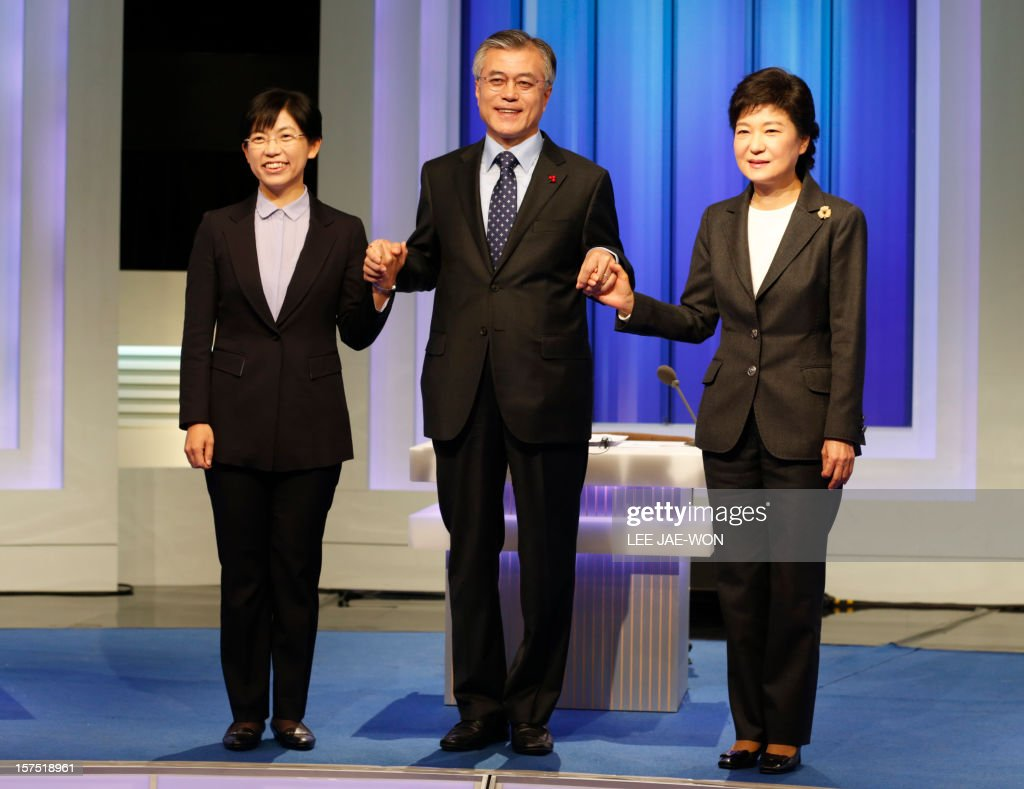 South Korea's presidential candidates (L-R), Lee Jung-Hee of the opposition Unified Progressive Party, Moon Jae-In of the main opposition Democratic United Party and Park Geun-Hye of the ruling Saenuri Party pose before a televised debate in Seoul on December 4, 2012. Conservative and right wing Park who is the daughter of late South Korean military dictator Park Chung-hee and the former human rights lawyer Moon, participated in a debate over security policy as North Korea readied a rocket launch that is timed to coincide with the South's presidential election.