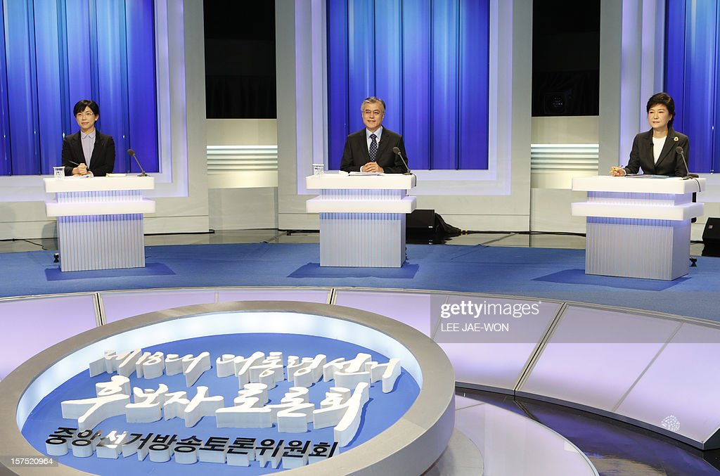 South Korea's presidential candidates (L-R), Lee Jung-Hee of the opposition Unified Progressive Party, Moon Jae-In of the main opposition Democratic United Party and Park Geun-Hye of the ruling Saenuri Party attend a televised debate in Seoul on December 4, 2012. Conservative and right wing Park who is the daughter of late South Korean military dictator Park Chung-hee and the former human rights lawyer Moon, participated in a debate over security policy as North Korea readied a rocket launch that is timed to coincide with the South's presidential election.