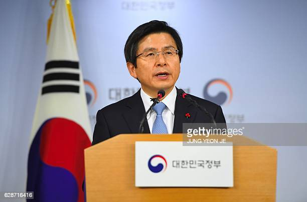 South Korea's Prime Minister and acting President Hwang KyoAhn delivers a public address at the government complex in Seoul on December 9 2016 after...