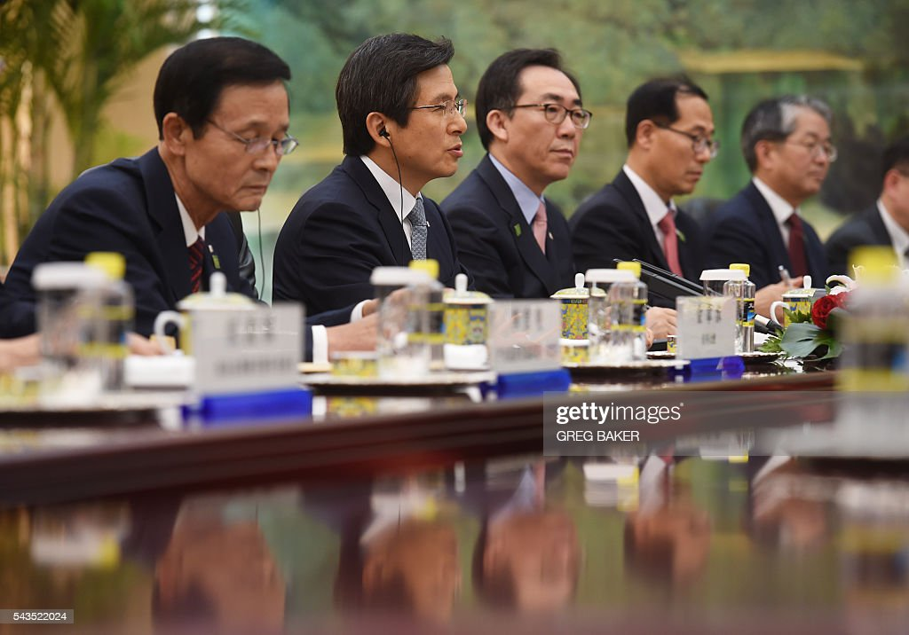 South Korea's Prime Minister Hwang Kyo-ahn (2nd L) speaks during a meeting with Chinese President Xi Jinping (not pictured) at the Great Hall of the People in Beijing on June 29, 2016. / AFP / POOL / GREG